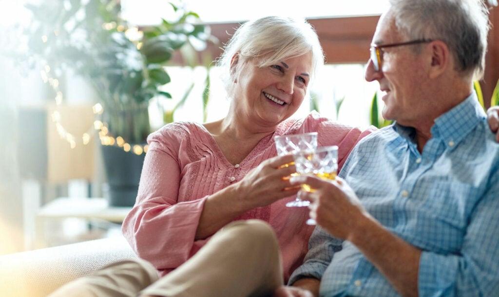Happy elderly couple enjoying a drink at their Tauranga Retirement Home