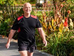Smiling elderly man walking through Retirement Village